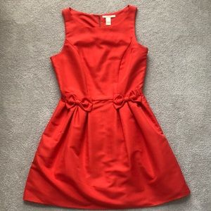 Orange A-line dress with bow detail